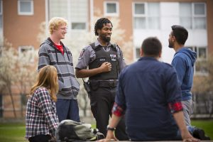 York University Security Officer chatting with students