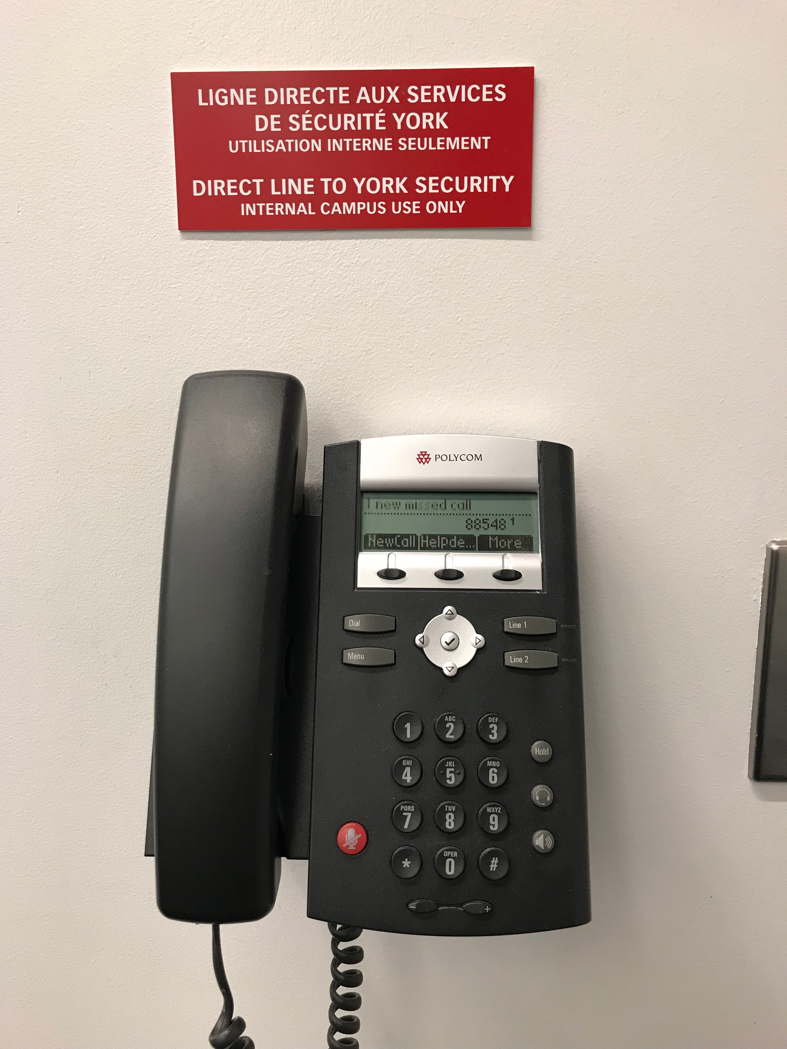 Phone Mounted to Wall With Signage of Direct Line to York Security